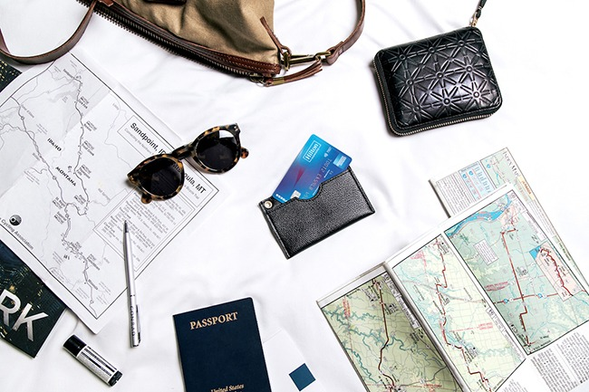 Hilton Honors Credit Card on Desk with travel documents