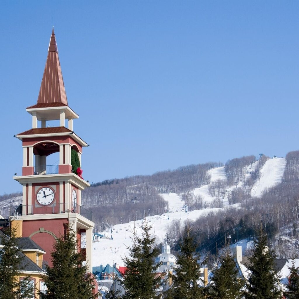 View of the clock tower and ski runs at Mont-Tremblant